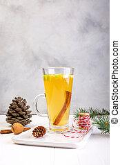Apple tea with cinnamon, Christmas background, warming winter drink