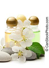 Apple tree flowers, stones and shampoo