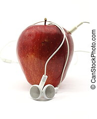 Apple with Earbuds - Red Delicious apple wrapped in music...