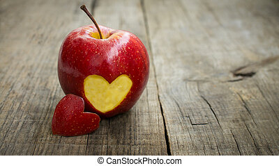 Apple with engraved heart - A red apple with engraved heart...