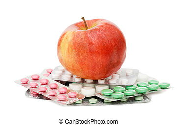 Apple with pills isolated on white background