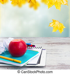 Apple with school supplies