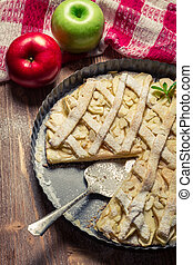 Apples and apple cake decorated with icing sugar