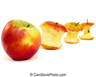 Apples and apple cores in a row