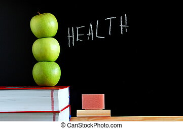 apples books and chalkboard showing healthy lifestyle