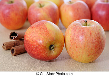 apples and cinnamon on table