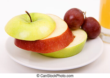 Apples and grapes on plate