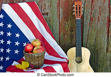 apples and guitar with flag