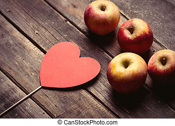 apples and heart shaped toy