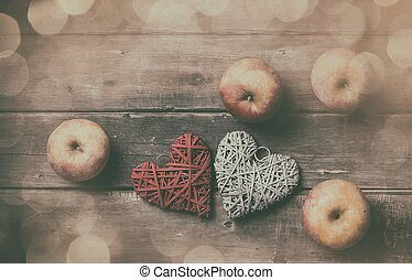 apples and heart shaped toys