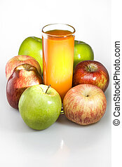 Apples and juice in glass