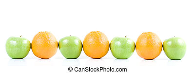 Row of green apples and oranges in straggered pattern. Isolated on white background