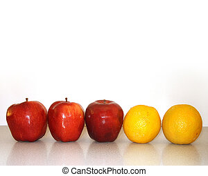 Apples and oranges - apples and oranges lined up on counter....