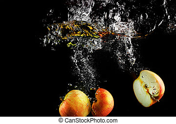 Apples falling into water