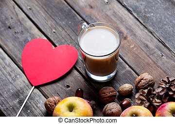 apples, fir-cones, cup of coffee, toy and nuts
