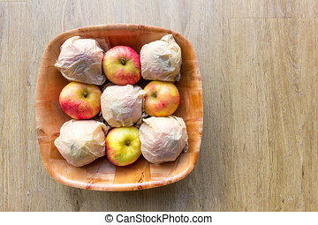 Apples for storing in a wooden bowl