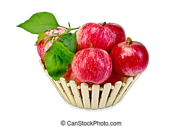 Apples fresh red in a wooden basket