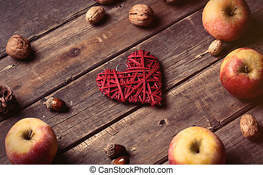 apples, heart shaped toy, fir-cone and nuts