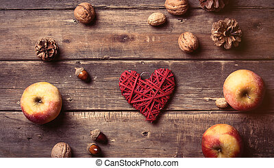 apples, heart shaped toy, fir-cones and nuts