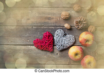 apples, heart shaped toys, fir-cones and nuts