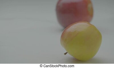 Apples hit, two organic whole moving fruits strike collide with each other, close up studio video. High quality 4k footage