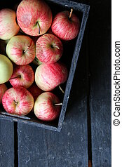 apples in a box on a vintage table