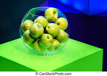 Apples in a glass round bowl