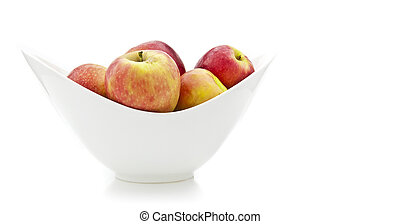 Apples in a white china bowl on white background