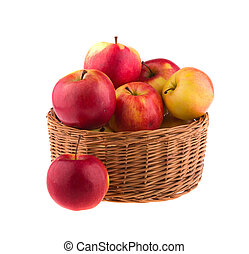 Apples in a wooden basket, isolated on white background.