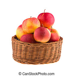 Apples in a wooden basket isolated on white background.