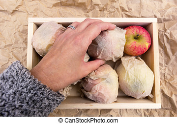 Apples in a wooden box for storing