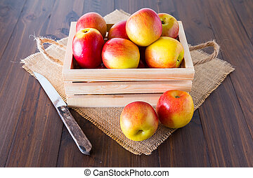 Apples in a wooden crate.