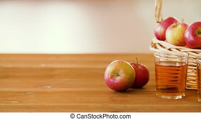 apples in basket and glasses of juice on table - fruits,...