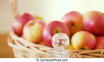 apples in basket and jug of juice on table - fruits, food...