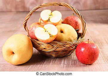Apples in basket on a wood background