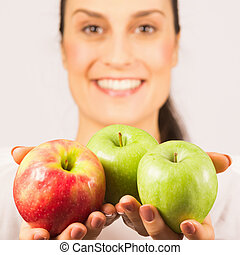 apples in female hands