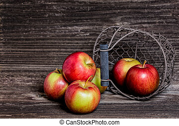 Apples in front of wooden wall