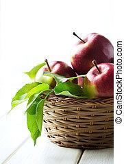Apples in wicker basket close up