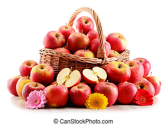 Apples in wicker basket isolated on white