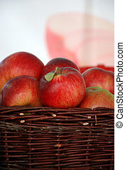 apples in wooden basket