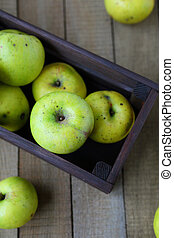 apples in wooden crate, top view