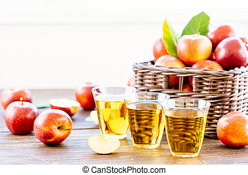 Apples juice in glass with apple in the basket