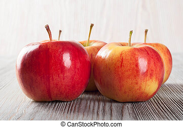 Apples on a wooden background.