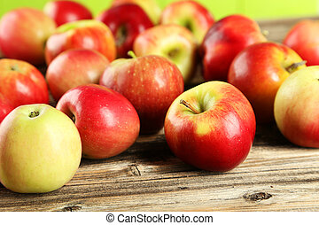 Apples on brown wooden background