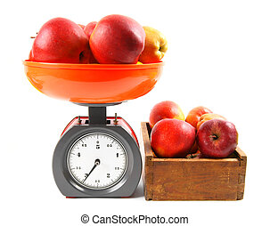 Apples on scales and in a box