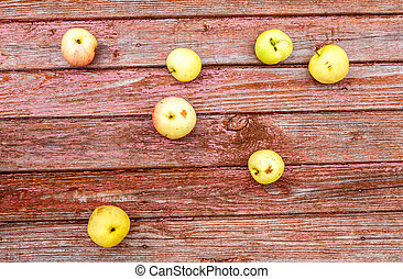 Apples on the weathered wooden table background