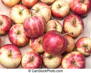 apples on wood background.