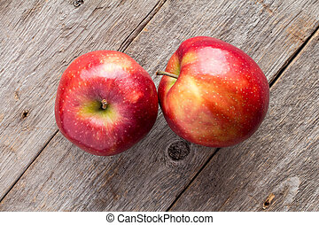 Apples on wooden background.