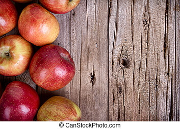 apples on wooden plank