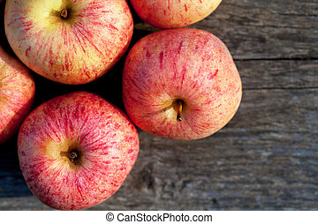 Apples - Top view of ripe red apples on a wooden plank